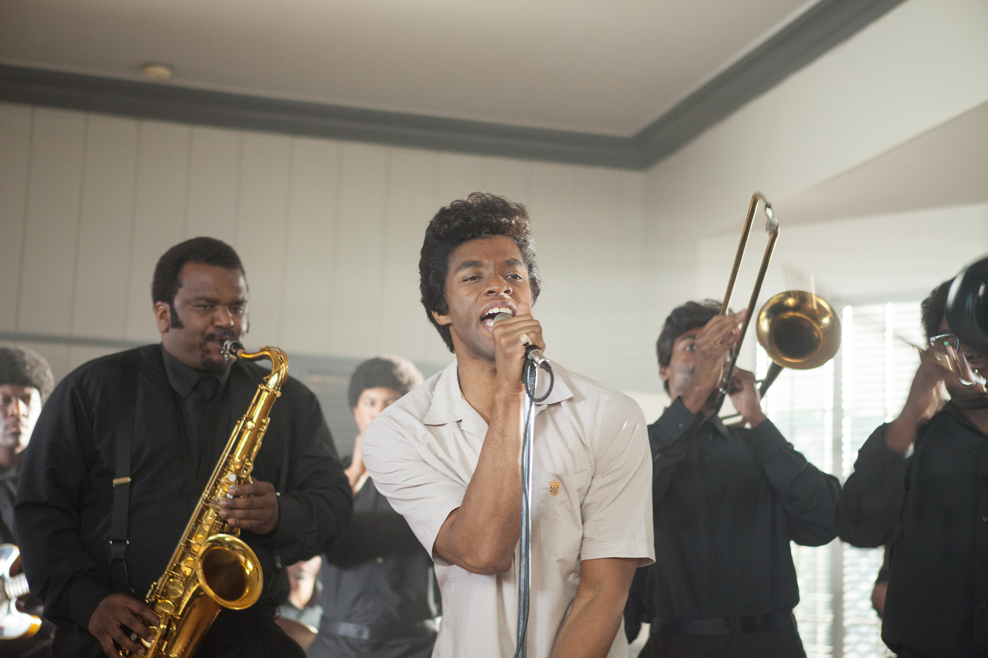 Chadwick Boseman (center) in Get On Up